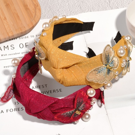 Mode Stickerei Schmetterling Perle Stirnband NHAQ321311's discount tags