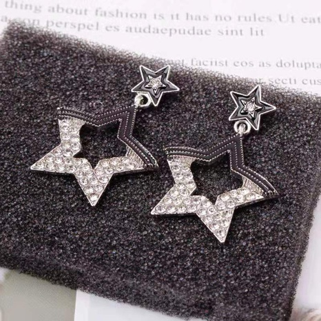 Rhinestone five-pointed star hollow earrings NHOT321635's discount tags