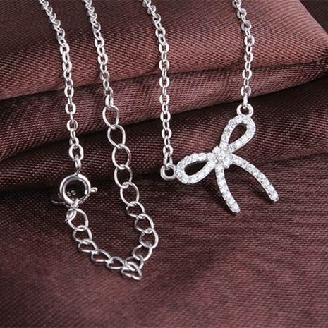 S925 Sterling Silver fashion bow Zircon Pendant necklace NHKL330939's discount tags
