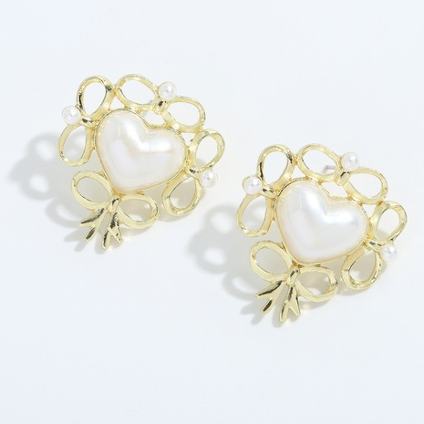 Korean heart alloy inlaid pearl earrings NHJQ334314's discount tags