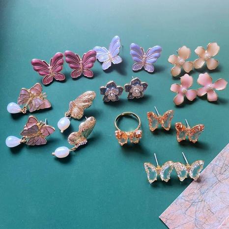 Mode bunte Emaille Blume Schmetterlingsohrringe NHOM335226's discount tags