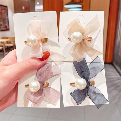 épingle à cheveux perle bowknot en fil net simple NHNA334778's discount tags
