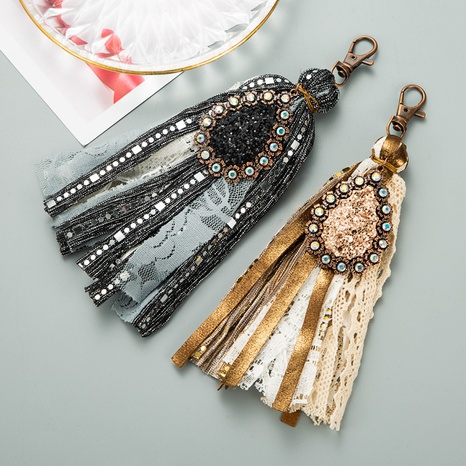 Korean alloy lobster clasp artificial leather tassel keychain NHLN335634's discount tags
