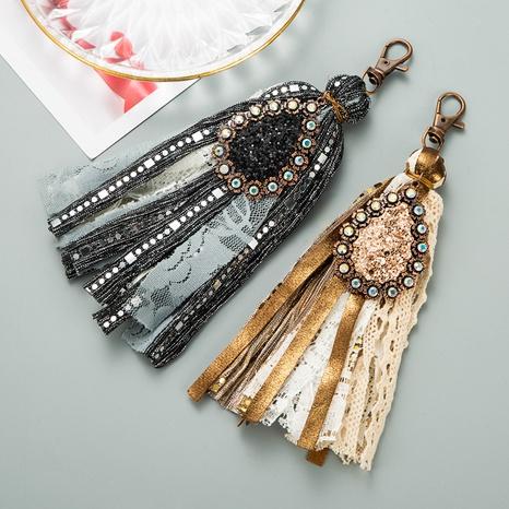Llavero de borla de cuero artificial con cierre de langosta de aleación coreana NHLN335634's discount tags