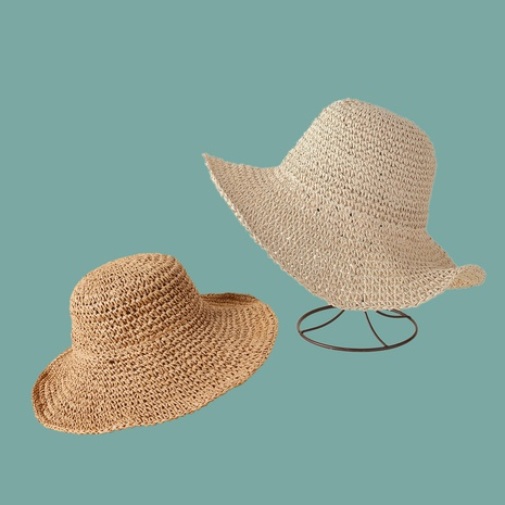Fashion big brimmed solid color sunscreen hand hook straw hat NHAMD335938's discount tags