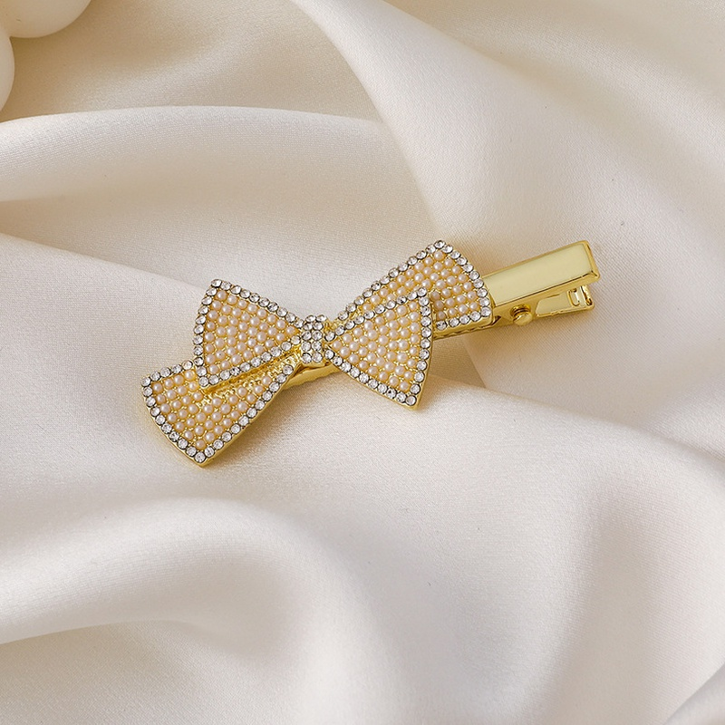 fashion bowknot pearl hairpin  NHMS336372