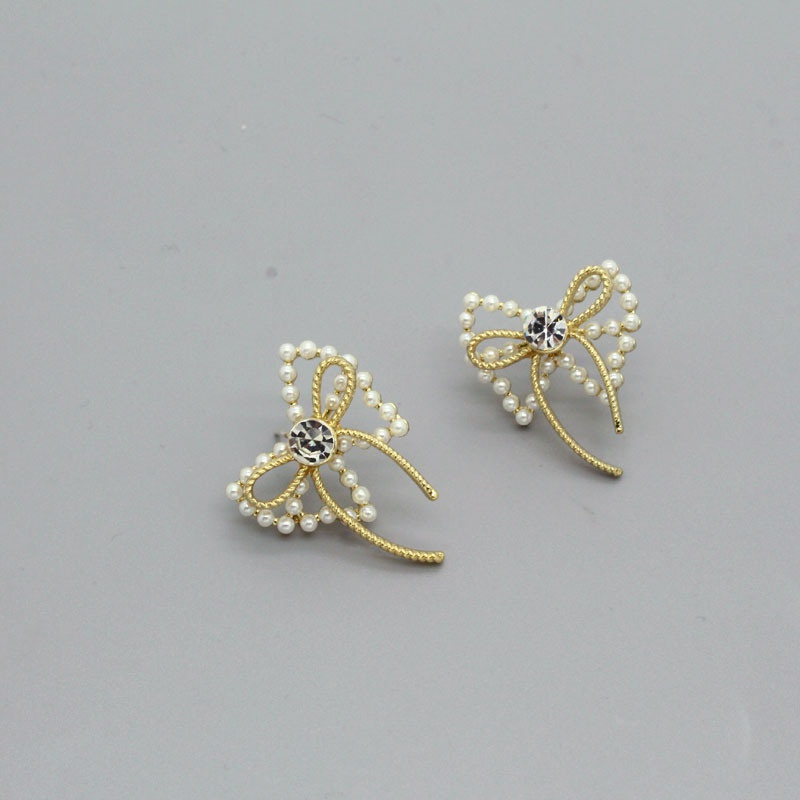 Korea Bowknot Pearl Alloy Earrings NHGO336517