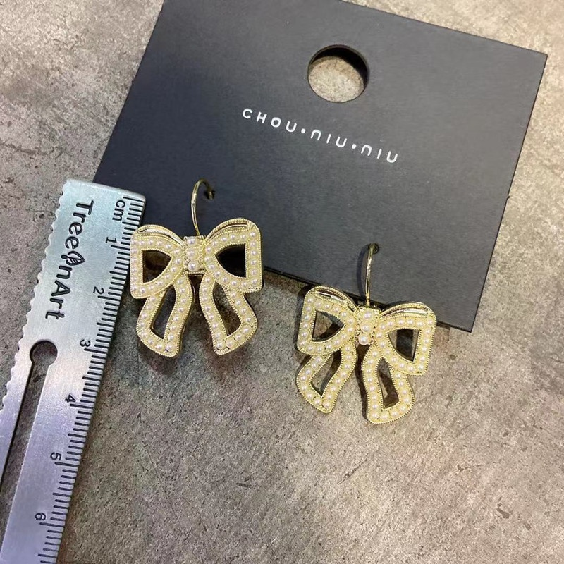 Bow Pearl Earrings NHOT336759