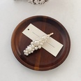 NHWB1557591-Golden-~-a-large-pearl-clip-about-9cm