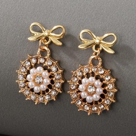 simples aretes de perlas con lazo dorado tachonado de diamantes NHGY336741's discount tags