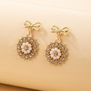 simple diamondstudded golden bow pearl earrings NHGY336741