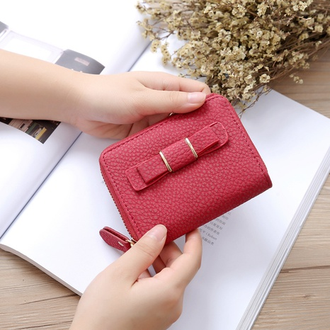 Korean short bow mini wallet NHLAN337354's discount tags