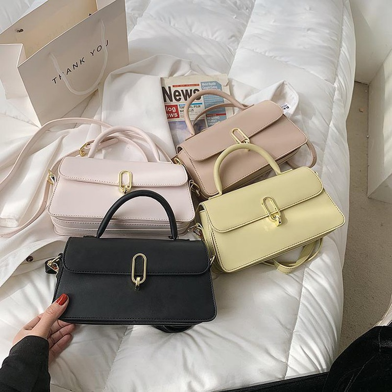 Fashion solid color shoulder messenger portable bag wholesale NHTG337734