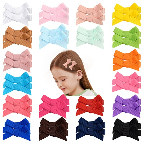 Multi-color children's bow clip set NHMO337855's discount tags