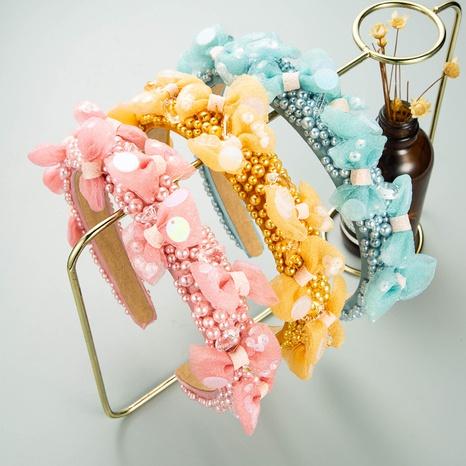 Korean bow pearl headband wholesale NHLN338450's discount tags