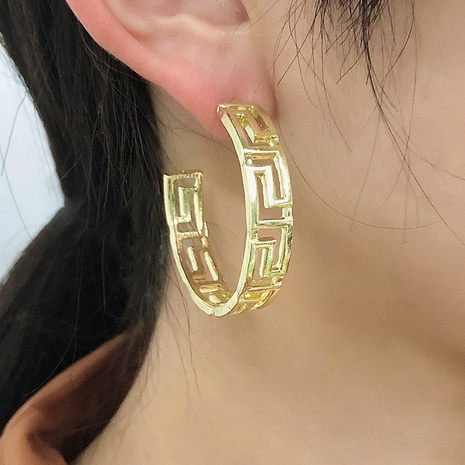 retro hollow metal C-shaped geometric earrings NHMD338616's discount tags