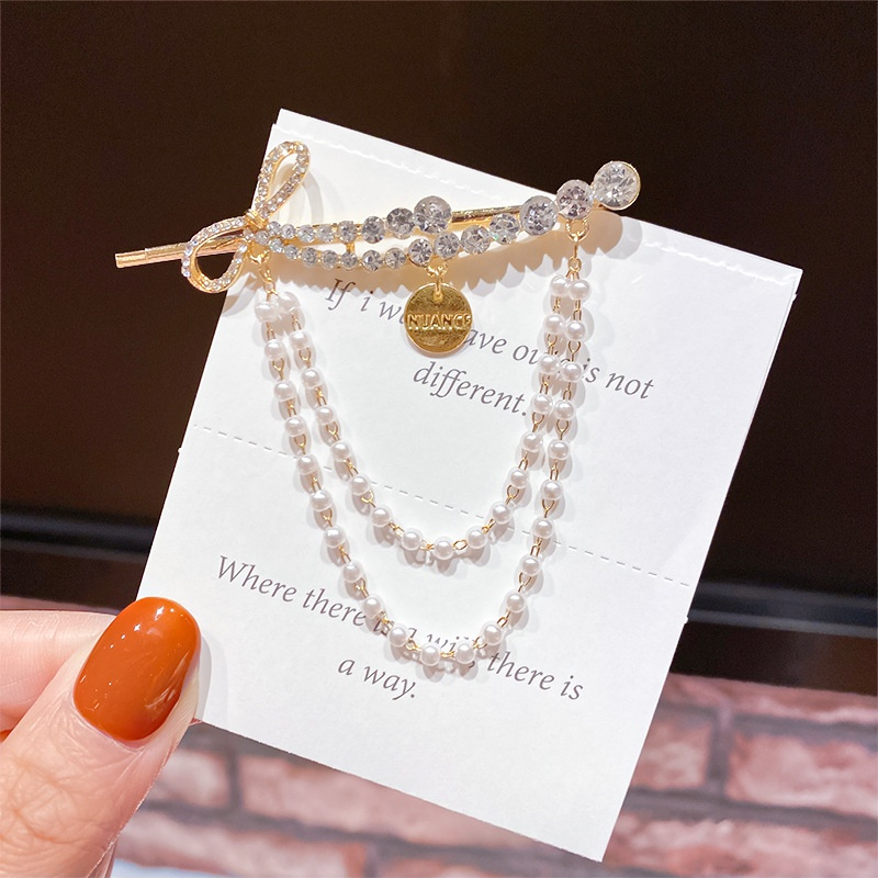fashion tassel pearl bowknot rhinestone hair clip NHNA338814