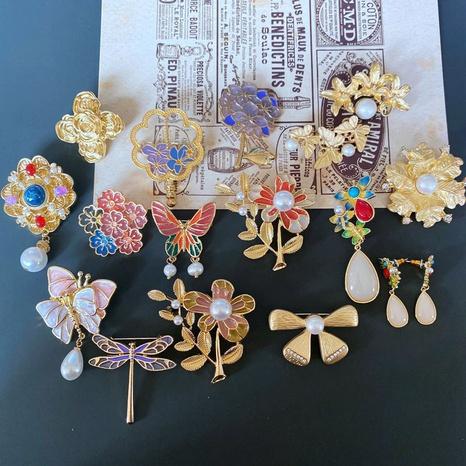 Mode Blumen Schmetterlinge Perle Legierung Ohrringe NHOM339941's discount tags