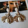 NHOM1573702-White-pearl-bee-silver-needle-stud-earrings