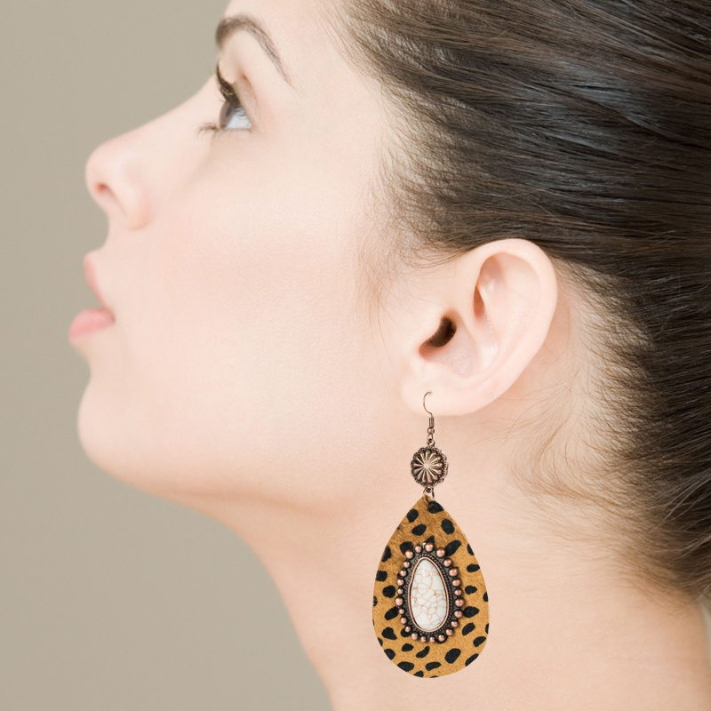 Exaggerated dropshaped leather leopard earrings alloy inlaid white turquoise bronze long earrings NHLN340764