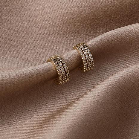 Boucles d'oreilles en cuivre de zircon micro-incrusté à trois couches courbées à la mode en gros NHMS341204's discount tags