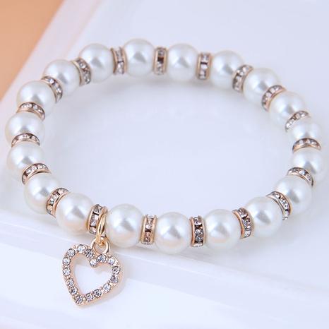 Korean Fashion alloy Pendant Pearl Love bracelet NHSC341547's discount tags