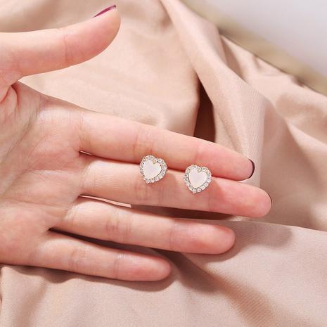 Boucles d'oreilles en alliage en forme de coeur en zircon doré micro-incrusté de mode en gros NHAN341672's discount tags