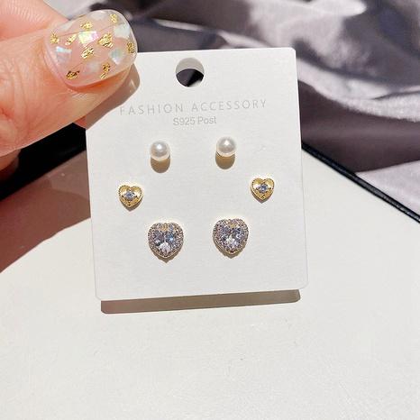 wholesale Ensemble de boucles d'oreilles en forme de coeur en zircon coréen NHCG342042's discount tags
