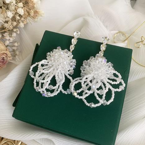 Mode weiße Blume Wassertropfen Kristalllegierung Ohrringe Großhandel NHWK342100's discount tags