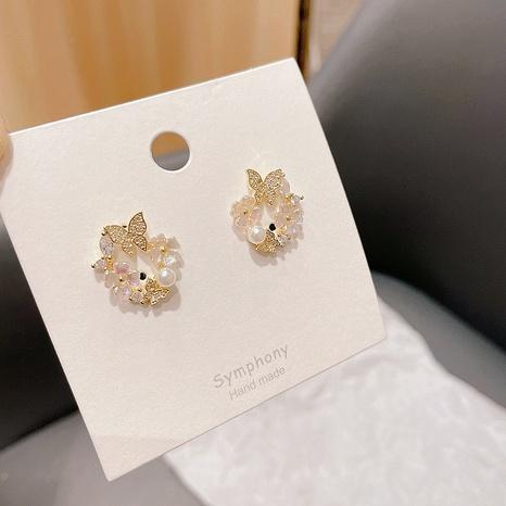 Koreanische Perle runde Schmetterling geometrische Legierung Ohrringe Großhandel NHHI342105's discount tags