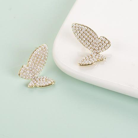 Mode Schmetterling Form eingelegte Perle Legierung Ohrringe Großhandel NHQIY342181's discount tags