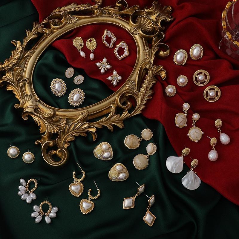 Fashion heartshape pearl alloy earrings wholesale NHMS342310