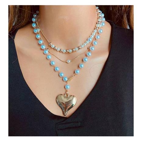 Collar de aleación en forma de corazón de perlas multicapa de moda al por mayor NHCT343660's discount tags