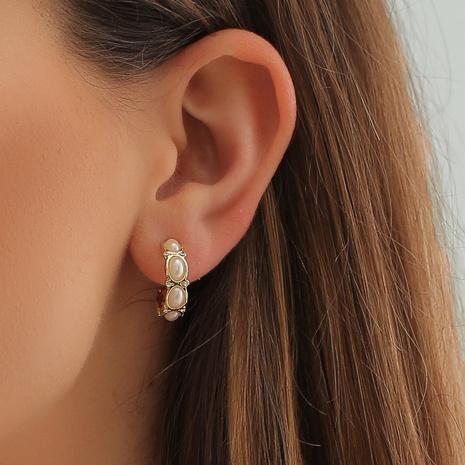Pendientes de cobre semicirculares de perlas de diamantes de imitación geométricos de moda al por mayor NHDP343820's discount tags