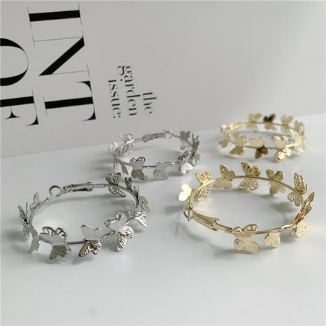 Koreanische C-förmige dreidimensionale goldene Schmetterlingsohrringe NHYQ331447's discount tags