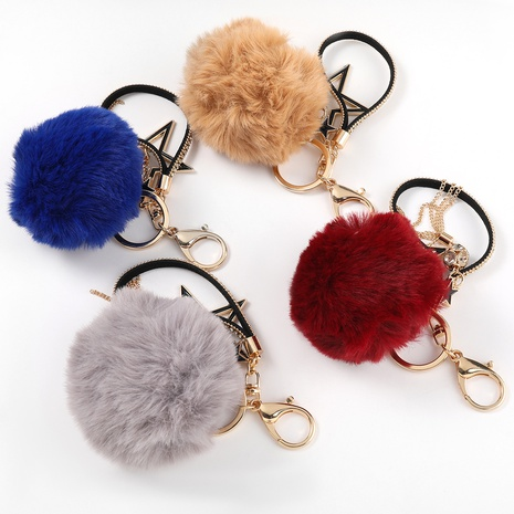 alloy oil drop diamond five-pointed star hair ball keychain NHJE331916's discount tags
