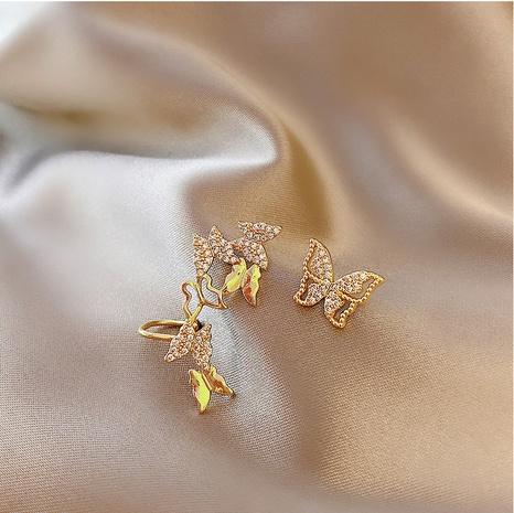 Asymmetrische Schmetterlingsohrringe mit vollem Diamanten NHOT332556's discount tags