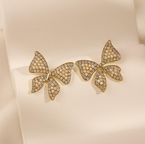 Imitation Pearl Schmetterlingsohrringe NHOT332555's discount tags