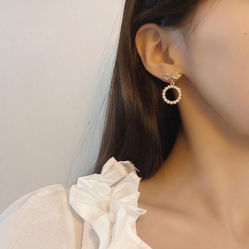 Korean bow pearl circle earrings  NHBY332702