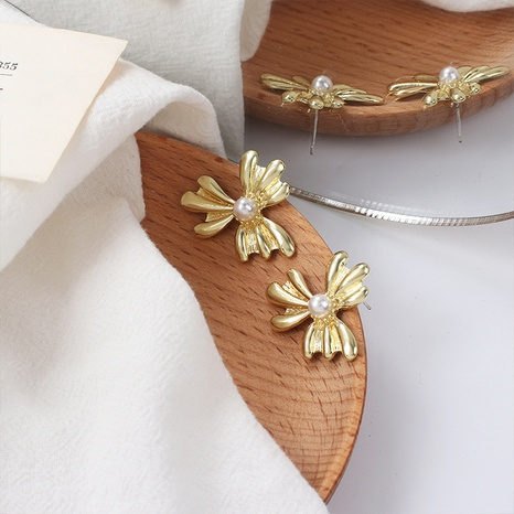 Fashion flower pearl alloy earrings wholesale NHRN347622's discount tags