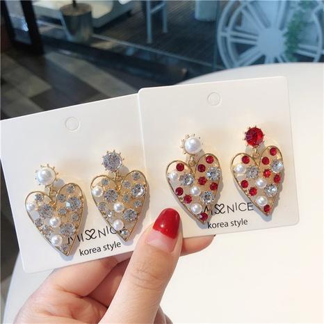 Fashion pearl rhinestone hollow heart-shape alloy earrings wholesale NHHER347652's discount tags