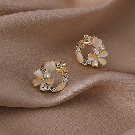Korea round small flower copper inlaid zircon earrings wholesale NHMS347723's discount tags