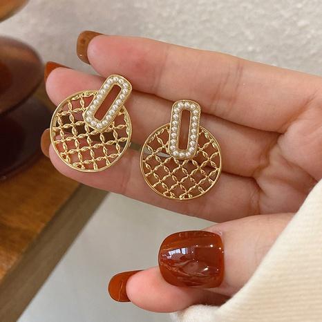 Fashion pearl metal circle mesh earrings wholesale NHXI347847's discount tags