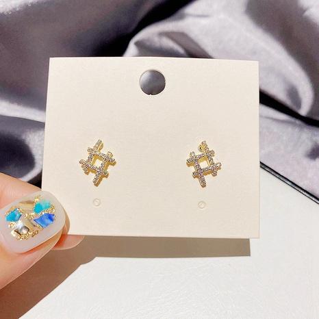 Korean copper inlaid zircon symbol earrings wholesale NHCG348112's discount tags