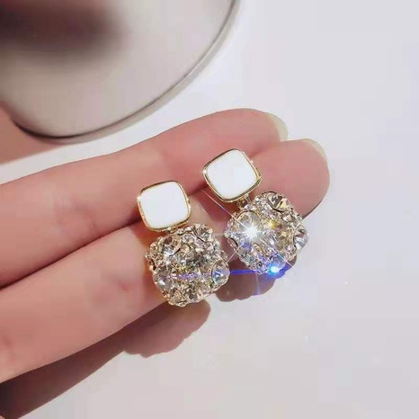 Fashion geometric full diamond dripping oil alloy earrings wholesale NHDQ348158's discount tags