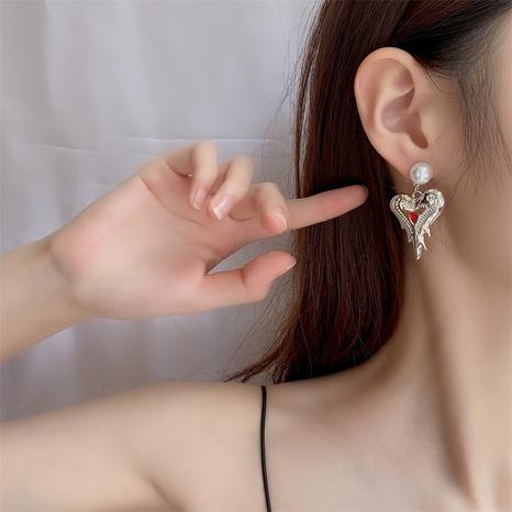 Nuevos aretes de corazón de melocotón con perlas barrocas asimétricas de Corea NHYQ349168's discount tags