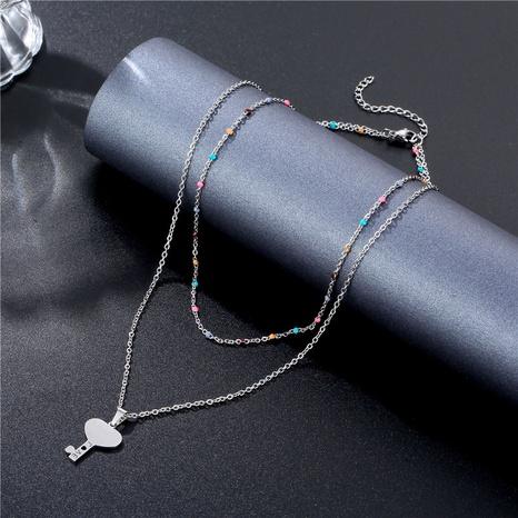 Collier en acier inoxydable à double couche clé en forme de coeur en gros NHAC349448's discount tags