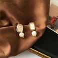 NHBY1617700-Pair-of-white-earrings