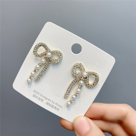 Boucles d'oreilles avec nœud en diamant de style coréen NHFS349864's discount tags
