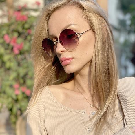 nuevo estilo de moda gafas de sol redondas sin marco NHLMO350257's discount tags
